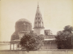 View of [the modern temple at] Sarnath [with the Dhamekh stupa in the background.